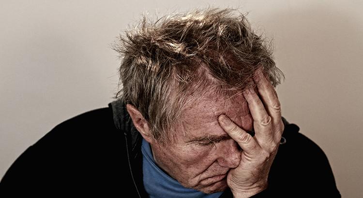 Kopfschmerz-Mann